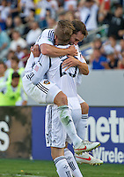 CARSON, CA - June 17, 2012: LA Galaxy teammates Todd Dunivant (2) and David Beckham (23) celebrate Dunivant's goal during the LA Galaxy vs Portland Timbers match at the Home Depot Center in Carson, California. Final score LA Galaxy 1, Portland Timbers 0.