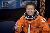 Houston, TX - (FILE) -- File photo dated July 16, 2008 shows Japan Aerospace Exploration Agency astronaut Koichi Wakata, Expedition 18 flight engineer, giving a thumbs-up signal as he awaits the start of a training session in the Space Vehicle Mockup Facility at NASA's Johnson Space Center. Wakata is wearing a training version of his shuttle launch and entry suit..Credit: NASA via CNP