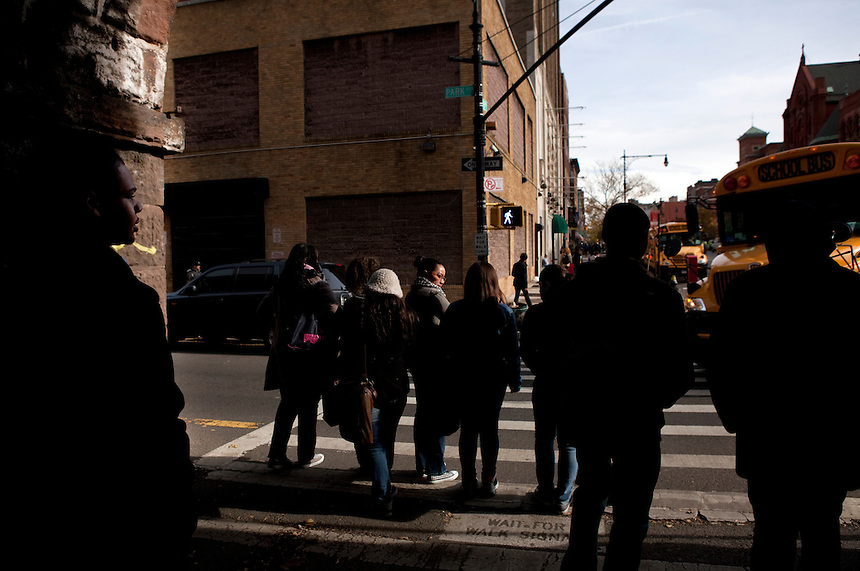 12th grader Brander Suero, 16, far left, heads down 106th Street in Harlem to buy lunch in New York, NY on November 15, 2012. Beyond sheer physical safety, a look at how schools and districts can create classroom conditions in which students are able to engage enthusiastically and without emotional fear of stepping forward. Photographer: Melanie Burford/Prime