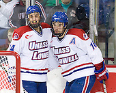Joseph Pendenza (Lowell - 14) and Riley Wetmore (Lowell - 16) celebrate Wetmore's second goal which tied the game at 2 just 2:48 into the third period. - The visiting Minnesota State University-Mankato Mavericks defeated the University of Massachusetts-Lowell River Hawks 3-2 on Saturday, November 27, 2010, at Tsongas Arena in Lowell, Massachusetts.
