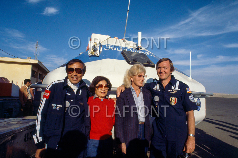 """February 1981, Luxor, Egypt --- Americans Maxie Anderson and Don Ida (of Japanese origin), with their wives, prior to their historic non-stop attempt to circle the globe in a hot air balloon named """"Jules Verne"""". --- Image by © JP Laffont"""