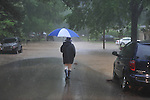 Ann Huggins walks around flash flooding on Chandler Avenue in Oxford, Miss. on Wednesday, April 27, 2011. Huggins' house had water inside of it.