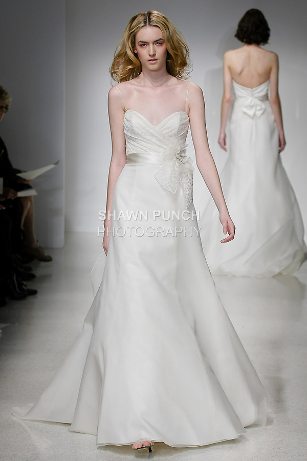 Model walks runway in an Aeryn wedding dress by Amsale Aberra, for the Christos Spring 2012 Bridal runway show.