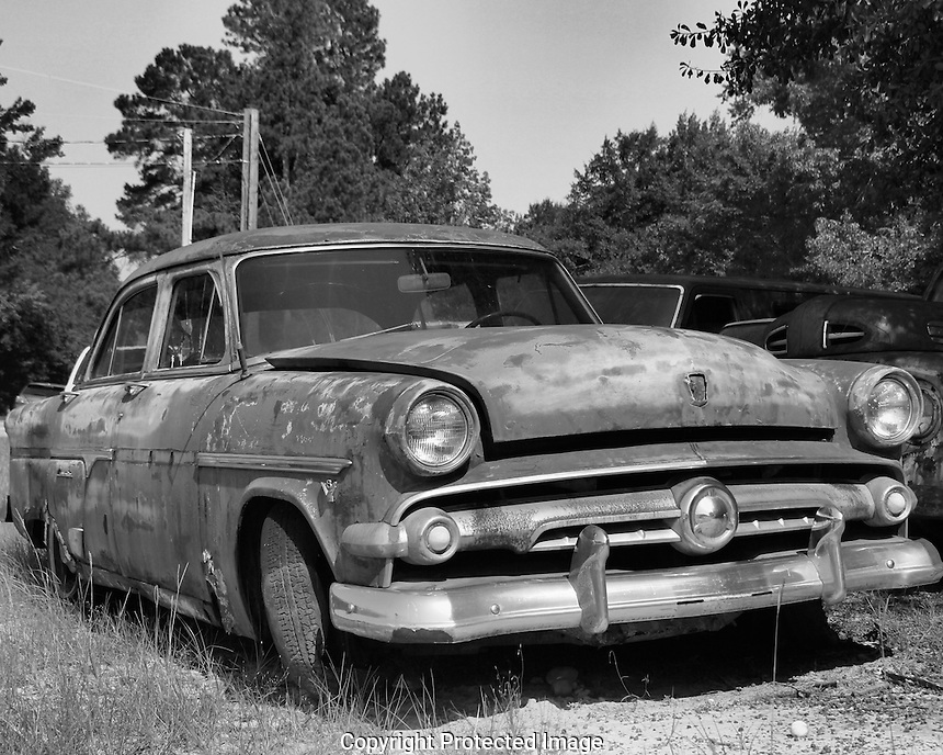This is another abandoned vehicle in the Williston graveyard. I can't remember but isn't it a Plymouth or maybe a Dodge/Desoto? A car restoration hobbyist would just love this place!