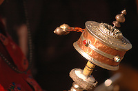The Prayer Wheel is the best-known Tibetan ritual object. From the smallest to the largest, prayer wheels contain sacred texts or mantra. The cylinder of the wheel is always rotated counter-clockwise and each turn is the equivalent to actually saying the prayers.