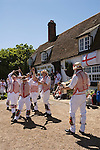 Morris dancing. The Thaxted Morris   d, Essex England. Dancing outside traditional english village country pub. 006