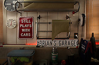 Reinholds, Pennsylvania, February 10, 2015 - Signs and masking paper on the wall of one of Brian Moyer's garages. <br /> <br /> Moyer owns 16 AMC Gremlins. The Gremlin was introduced on April Fools Day (April 1) in 1970 featuring a shortened Hornet body with a Kammback tail and was manufactured in the US via AMC and in Mexico via AMC's subsidiary VAM. It's lifecycle ended in 1978 when it was replaced by the AMC Spirit. Moyer became interested as a kid when he saw the early Gremlin commercials in 1970. His first car was a Gremlin and he has never not owned one. Today he has arguably the most unique collection of Gremlins in the world, including several that are one-of-a kind models. <br /> <br /> CREDIT: Daryl Peveto for The Wall Street Journal<br /> Photo Assignment ID: 36892 <br /> Slug: MYRIDE_Gremlin