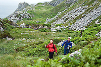 Sheeps Head Peninsula, West Cork, Ireland July 2010.  Hikers on the trail at Tooreen, near the lighthouse and on the way to the cove. The Sheep's Head Way is an 88 km long distance hiking trail which combines the low, rugged hills and a splendid cliff coastline with quieter roads, paths and tracks to make a complete circuit around the Sheep's Head Peninsula. Photo by Frits Meyst/Adventure4ever.com