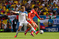 Aleksandr Kokorin of Russia and Marouane Fellaini of Belgium