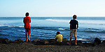 Threee young boys checks the surf conditions in Tenerife,Canary Islands.