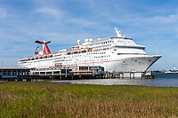 Cruise ship Carnival Ecstasy docked at the cruise ship passenger terminal on the Cooper River in Charleston, South Carolina.
