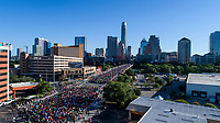 Runners take starting line positions on the Congress Avenue Bridge during the Statesman Cap10K in downtown Austin, Texas
