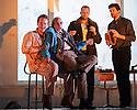 London, UK. 14.10.2015. English National Opera presents, in a co-production with Dutch National Opera, Amsterdam, Puccini's LA BOHEME, at the London Coliseum. Picture shows: Duncan Rock (Marcello), Simon Buteriss (Benoit), Ashley Riches (Schaunard), Zach Borichevsky (Rodolfo).  Photograph © Jane Hobson.