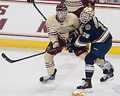 Steven Santini (BC - 6), Peter Schneider (ND - 15) - The visiting University of Notre Dame Fighting Irish defeated the Boston College Eagles 2-1 in overtime on Saturday, March 1, 2014, at Kelley Rink in Conte Forum in Chestnut Hill, Massachusetts.