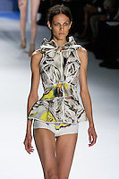 Aymeline Valade walks runway in a White psychedelic printed stretch cotton vest with oversized joke and drawstring peplum belt, White psychedelic printed boy shorts, by Vera Wang, for the Vera Wang Spring 2012 collection, during Mercedes-Benz Fashion Week Spring 2012.