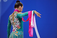 Liubov Charkashyna of Belarus begins routine with ribbon at 2010 Pesaro World Cup on August 29, 2010 at Pesaro, Italy.  Photo by Tom Theobald.