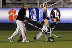 2 November 2005: North Carolina goalkeeper Aly Winget is carted off following a second half injury sustained in a collision with Maryland's Kaila Sciascia (not pictured). The University of North Carolina defeated the University of Maryland 3-1 at SAS Stadium in Cary, North Carolina in the quarterfinals of the 2005 ACC Women's Soccer Championship.