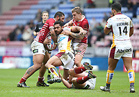 Huddersfield Giants' Sebastine Ikahihifo is tackled by Wigan Warriors' Ben Flower, Frank-Paul Nu'uausala and Sam Powell <br /> <br /> Photographer Stephen White/CameraSport<br /> <br /> Betfred Super League Round 5 - Wigan Warriors v Huddersfield Giants - Sunday 19th March 2017 - DW Stadium - Wigan<br /> <br /> World Copyright &copy; 2017 CameraSport. All rights reserved. 43 Linden Ave. Countesthorpe. Leicester. England. LE8 5PG - Tel: +44 (0) 116 277 4147 - admin@camerasport.com - www.camerasport.com