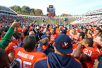 Oct 30, 2010; Charlottesville, VA, USA;   The Virginia Cavaliers head coach Mike London celebrates with his team after 24-19 upset win over the Miami Hurricanes at Scott Stadium. Mandatory Credit: Andrew Shurtleff