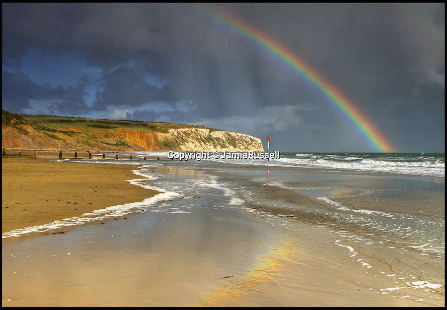 BNPS.co.uk (01202 558833)<br /> Pic: JamieRussell/BNPS<br /> <br /> ***Please Use Full Byline***<br /> <br /> A rainbow over Culver Cliff.<br /> <br /> Stunning photographs have revealed a turbulent side to the normally genteel Isle of Wight.<br /> <br /> The seemingly benign south coast holiday destination has been catalogued over a stormy year by local photographer Jamie Russell, and his astonishing pictures reveal the dramatic changes in weather that roll across the UK in just 12 months.<br /> <br /> Lightning storms, ice, floods, gales and blizzards have all been captured by the intrepid photographer who frequently got up in the middle of the night to capture the climatic chaos.<br /> <br /> Looking at these pictures prospective holidaymakers could be forgiven for thinking twice about a gentle staycation on the south coast island.