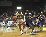 "Mississippi guard Nick Williams (20) is defended by Alcorn State's Tony Eakles (30) at the C.M. ""Tad"" Smith Coliseum in Oxford, Miss. on Thursday, December 29, 2010. (AP Photo/Oxford Eagle, Bruce Newman)"