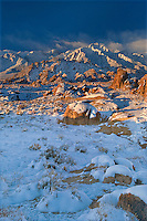 711700253 winter sunrise over mount langley and lone pine peak with snow covered granite boulders in the foreground in the alabama hills blm lands in the southern section of the eastern sierras in kern county california
