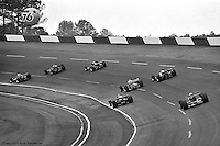 HAMPTON, GA - APRIL 22: A group of cars race through Turn #1 during the Gould Twin Dixie 125 event on April 22, 1979, at Atlanta International Raceway near Hampton, Georgia.