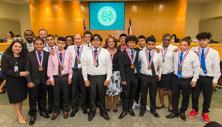 Houston ISD Trustee Rhonda Skillern-Jones poses for a photograph with members of the Washington High School Boy's Soccer Team during a Houston ISD Board of Trustee meeting, May 11, 2017.