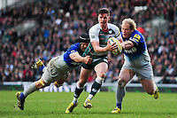 Freddie Burns of Leicester Tigers is double-tackled by Alistair Hargreaves and Petrus Du Plessis of Saracens. Aviva Premiership match, between Leicester Tigers and Saracens on March 20, 2016 at Welford Road in Leicester, England. Photo by: Patrick Khachfe / JMP