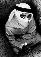 &quot;Where is the Exit?&quot; by Reem Al Falahi. Arab man with his face covered and enclosed by walls that surround him.