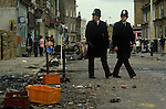 Brixton Riots. South London Uk April 1981. Police on duty the day after local people look at damage caused to their neighbourhood.