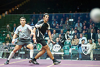 Thierry Lincou from France battling it out against Omar Mosaad from Egypt during  a match at the 2010 US Open Squash Championships benefitting METROsquash held at Chicago's Millenium Park .