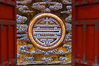 A red door opens onto the symbol of prosperity in some royal ruins in Hue, Vietnam.