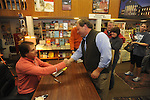 "Retired St. Louis Cardinals manager Tony La Russa signs copies of his book ""One Last Strike"" for Bubba Rowland at Square Books in Oxford, Miss. on Thursday, November 29, 2012."