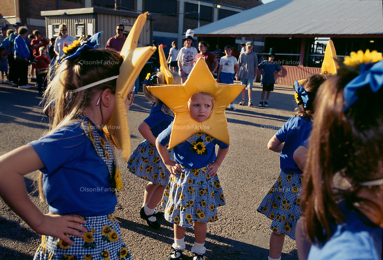 County fairs are filled with talent contests for all ages. Young girls, decked out in stars and sunflowers, prepare to parade before their families at the Brazoria County Fair in Angleton, Texas.