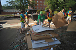 Volunteers break down boxes as students began moving into Stockard-Martin Dorm at the University of Mississippi in Oxford, Miss. on Friday, August 19, 2011. Classes begin on Monday, August 22, 2011.