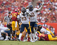 September 22, 2012: California's Chris McCain celebrates Josh Hill's forced fumble recovery during a game against USC  at the Los Angeles Memorial Coliseum, Los Angeles, Ca  USC defeated California 27- 9