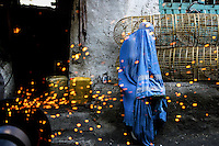 An Afghan woman sits in the Bazaar at the <br /> &quot;Old Kabul&quot; /Felix Features