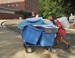 University of Mississippi freshman Kaitlyn Cochran, left, and her mother Sherry Cochran roll items on a cart as students began moving into Stockard-Martin Dorm in Oxford, Miss. on Friday, August 19, 2011. Classes begin on Monday, August 22, 2011.  (AP Photo/Oxford Eagle, Bruce Newman)