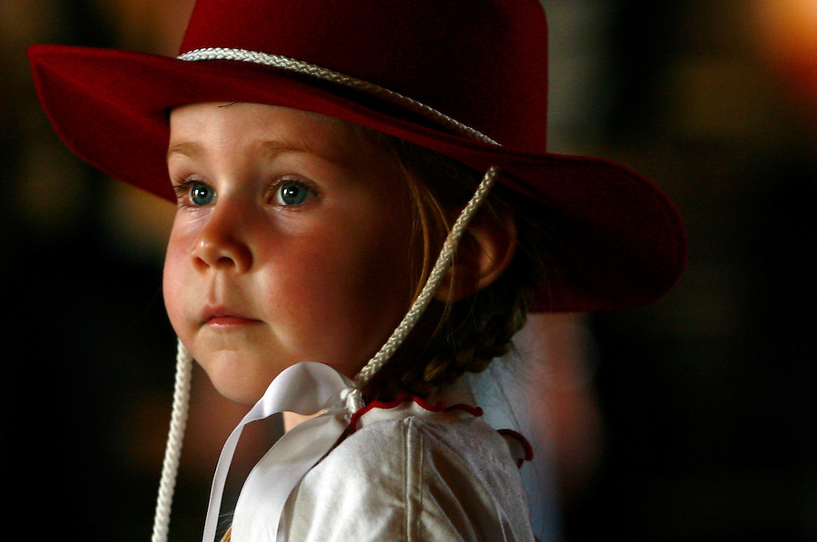 A girl dressed in her best dancing outfit watches as people arrive for the Alles Barn Dance.<br />