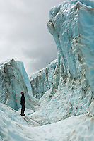 Ice climber looking at glacier, Franz Josef Glacier, New Zealand