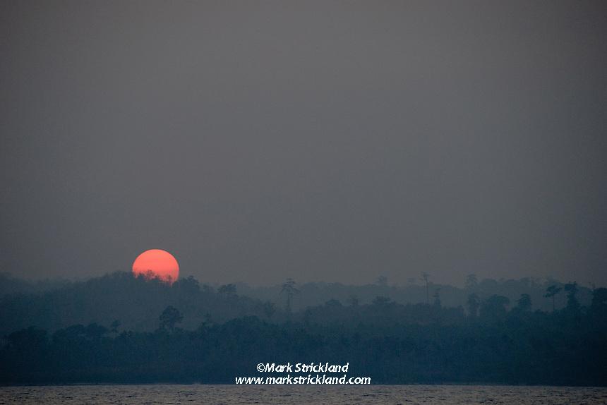 The sun sets over virgin rainforest at South Andaman, Andaman Islands, India