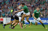 Jared Payne of Ireland is tackled in possession. Rugby World Cup Pool D match between Ireland and Romania on September 27, 2015 at Wembley Stadium in London, England. Photo by: Patrick Khachfe / Onside Images
