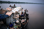 BOKONDO, DEMOCRATIC REPUBLIC OF CONGO APRIL 6: Unidentified people on a boat with destination Kinshasa on April 6, 2006 in Bokondo, Congo, DRC. Passengers sleep in the open, often on top of maize bags or other cargo. The boat carries many animals such as pigs, goats, crocodiles, monkeys, lizards, etc. The Congo River is a lifeline for millions of people, who depend on it for transport and trade. The journey from Kisangani to Kinshasa is about 1750 kilometers, and it takes from 3-7 weeks on the river, depending on the boat. During the Mobuto era, big boats run by the state company ONATRA dominated the traffic on the river. These boats had cabins and restaurants etc. All the boats are now private and are mainly barges that transport goods. The crews sell tickets to passengers who travel in very bad conditions, mixing passengers with animals, goods and only about two toilets for five hundred passengers. The conditions on the boats often resemble conditions in a refugee camp. Congo is planning to hold general elections by July 2006, the first democratic elections in forty years. (Photo by Per-Anders Pettersson)...