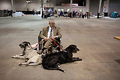 Steve LeVan, of Camden, S.C., with his two show dogs, Ellie and Phoebe. Kennel Club Dog Show, Championship Purebred AKC, Graham Building, N.C. State Fairgrounds. Sunday, March 25, 2012.