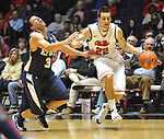 "Mississippi's Marshall Henderson (22) fouls East Tennessee State's Mario Stramaglia (3) at the C.M. ""Tad"" Smith Coliseum in Oxford, Miss. on Saturday, December 14, 2012.  (AP Photo/Oxford Eagle, Bruce Newman).."