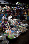 "Women sell fresh river fish and crab at a market in Long Xuyen, the capital of An Giang Province, Vietnam. When the Mekong River reaches Vietnam it splits into two smaller riveres. The ""Tien Giang"", which means ""upper river"" and the ""Hau Giang"", which means ""lower river"". Photo taken on Monday, December 8, 2009. Kevin German / Luceo Images"