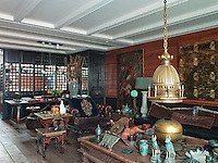 The living room is an extraordinary mixture of period styles arranged to form a carefully conceived but very relaxed home