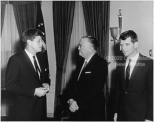 Visit of United States Attorney General Robert F. Kennedy and Director of the Federal Bureau of Investigation (FBI) J. Edgar Hoover to the Oval Office at the White House on February 23, 1961.   Left to right: U.S. President John F. Kennedy;  Director of the FBI J. Edgar Hoover; U.S. Attorney General Robert F. Kennedy. .Credit: White House via CNP
