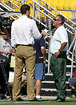 Leo Cuellar (r), Mexico's head coach, is interviewed during practice on Saturday, October 22nd, 2005 at Blackbaud Stadium in Charleston, South Carolina. The Mexico Women's National Team went through a light practice the day before a game against United States.